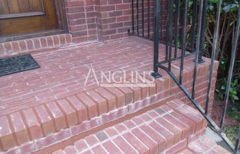 outdoor brick steps after levelling and mortar repair