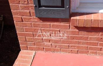 brick wall with cracks between the bricks after they've been fixed and filled