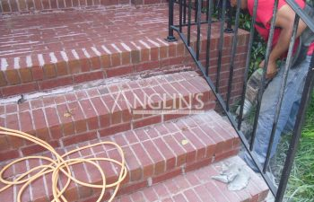 anglin's worker while repairing outdoor brick steps