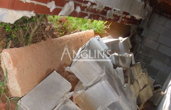 stack of bricks after a wall fell over