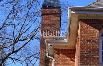 a house with a chimney that is leaning after anglin straighten it