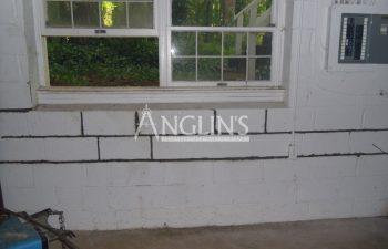 wall after anglin repaired the cracks between the bricks