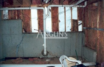 a week basement wall with visible isolation before anglin took care of it