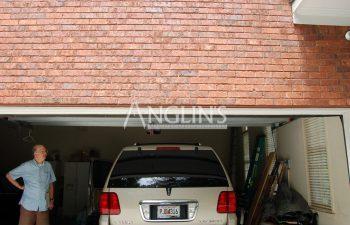 wall above a garage door after crack repair