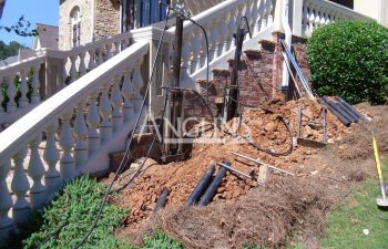 two piers installed to repair sinking outdoor baluster steps