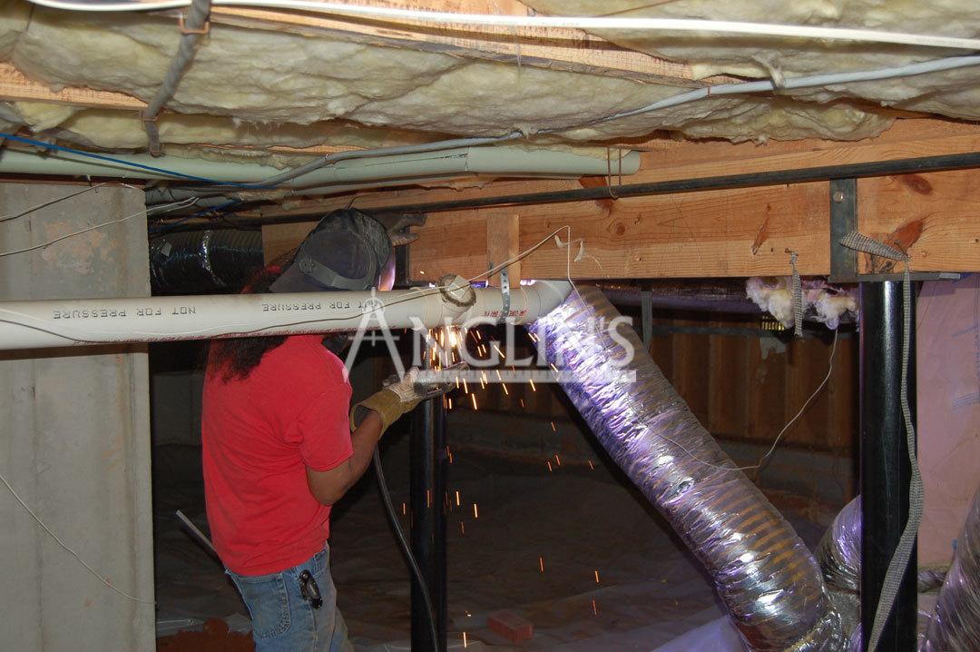 An Anglin Employee Welding A Support Beam