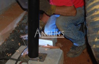 an anglin employee welding a support beam