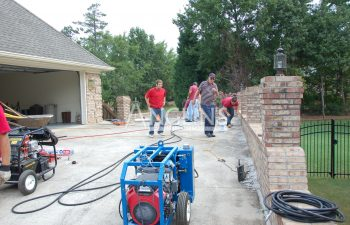 four anglin employees working in the driveway