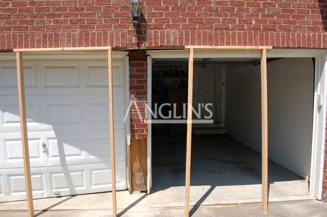 Garage Door Opening Repair Settling Cracking Bricks Mortar