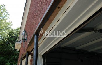steel support holding a frame of a garage door