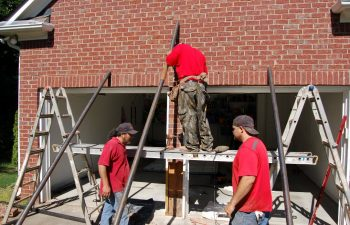 three anglin's employees during garage doors repair
