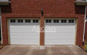 two garage doors after repair