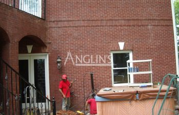 two anglin employees fixing a cracked wall