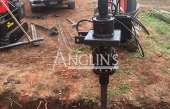 anglin's worker installing a helical pier