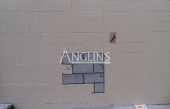 a hole in a wall after anglin fixed it and replaced the bricks