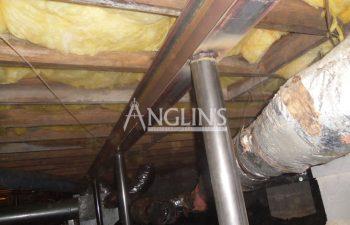 steel support beams under the floor of a bulding