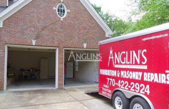 anglin's truck in front of repaired garage wall and doors