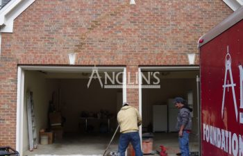 two anglin's employees while fixing a garage wall and doors