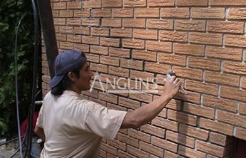 an anglin employee filling wall cracks