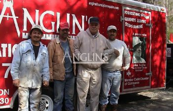 four anglin employees next to an anglin trailer
