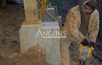 two anglin's worker excavating a deck support column