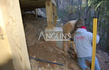 two anglin's workers excavating a deck support column