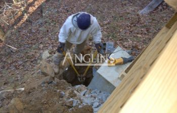 anglin's employee excavating deck foundation