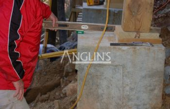anglin's employee checking deck support column leveling