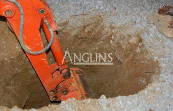 mini excavator digging in the ground
