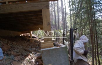 piers supporting and leveling a deck post and footing