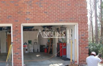 anglin's employee forming ecavations alongside a garage walls