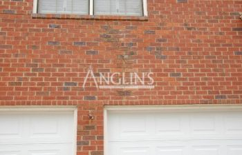 garage wall after masonry repair done by anglin's team