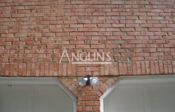 wall over the garage door after mansonry repair done by anglin's team