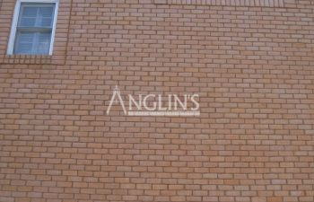 brick wall after masonry repair done by anglin's team