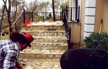 anglin's employee while stone patch work and leveling stoops