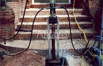 piers installed to push up sinking stoops