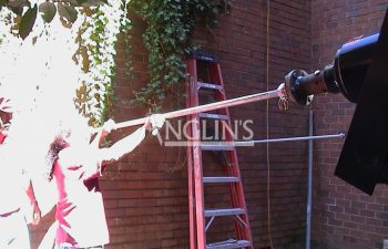 two anglin employees trying to level a wall