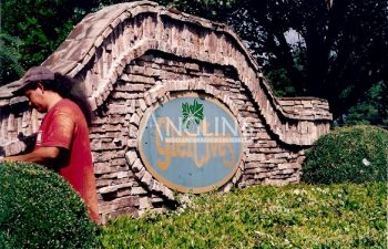 an anglin employee in front of a brick glen ives banner after he fixed a crack in the banner