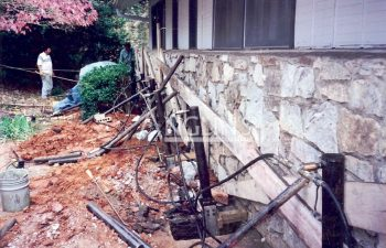 anglin's team using hydraulic piers while repairing a falling wall