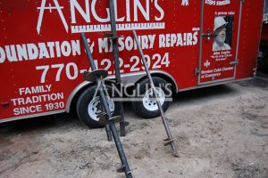 anglins trailer with 3 drills leand agains it