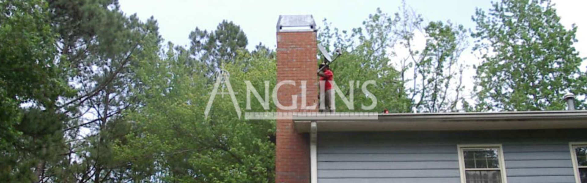 anglins worker on a roof repairing a chimney
