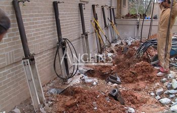 anglin's employee installing hydraulic piers