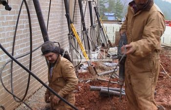 two anglin's workers while installing hydraulic piers