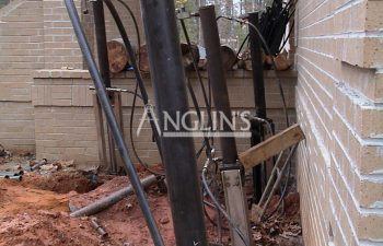 hydraulic piers installed alon exterior wall while repair