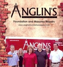anglin's family with company logo in the background