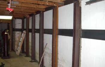steel brackets installed along interior walls to support sinking floor